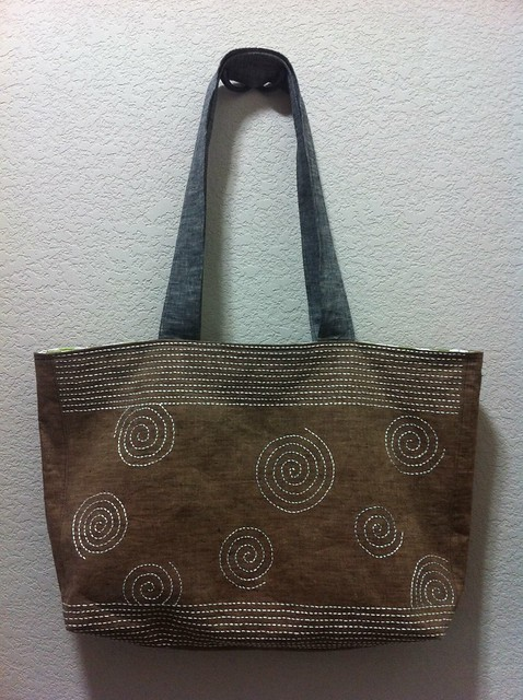 Sashiko tote bag, side 1, yokogushi rows and Archimedean spirals.