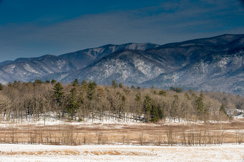 Later in the day the mountains took on a different color and with the warming temperatures and snow melting, more of the grass became visible and provided a warm contrast to the cool mountains and sky. 1/50 @ f22, ISO 200, Cokin graduated ND filter.