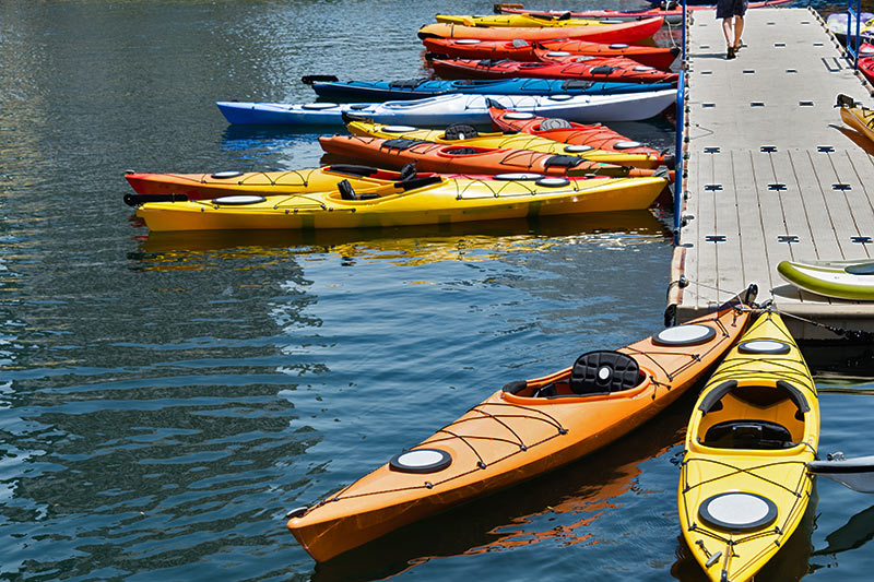 Sea Kayaks waiting for a adventurers to come to Vancouver Island, British Columbia, Canada.
