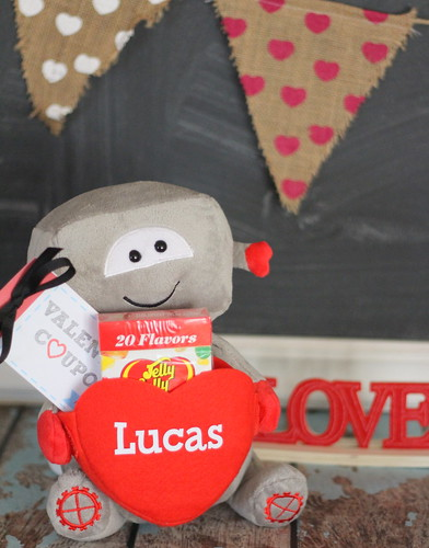 Valentine's Day Printables coupons with Love desk ornament decoration stuffed kid toy with conversation heart candies in front of chalkboard