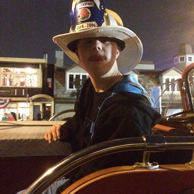 Chillin on the lead fire truck before the Christmas parade down Main Street, as you do.