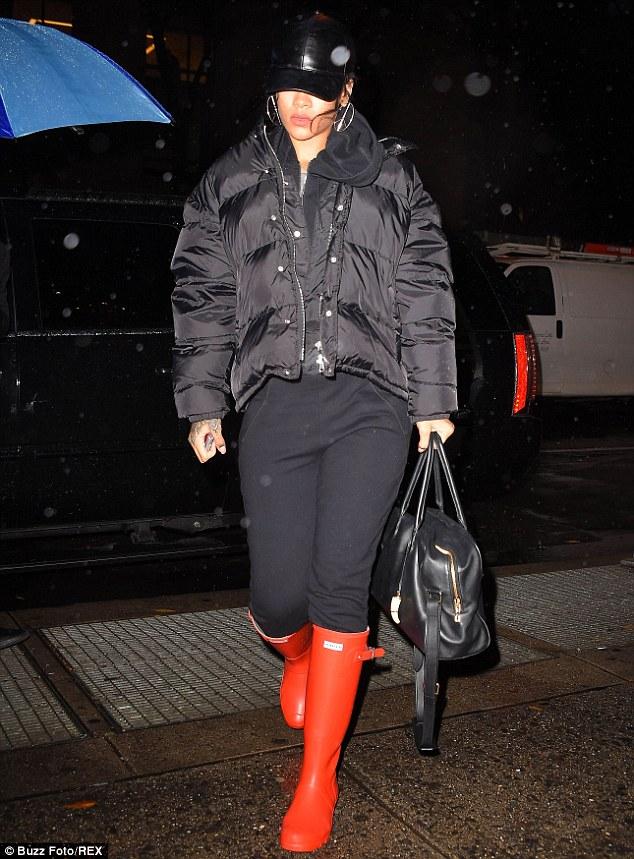 Rihanna-in-orange-Hunter-original-tall-Wellington-boots,orange blazer, oversize orange blazer, orange monochrome look, orange head to toe, how to wear orange head to toe, how to wear all over orange, AQ/AQ Bowie orange draped maxi dress