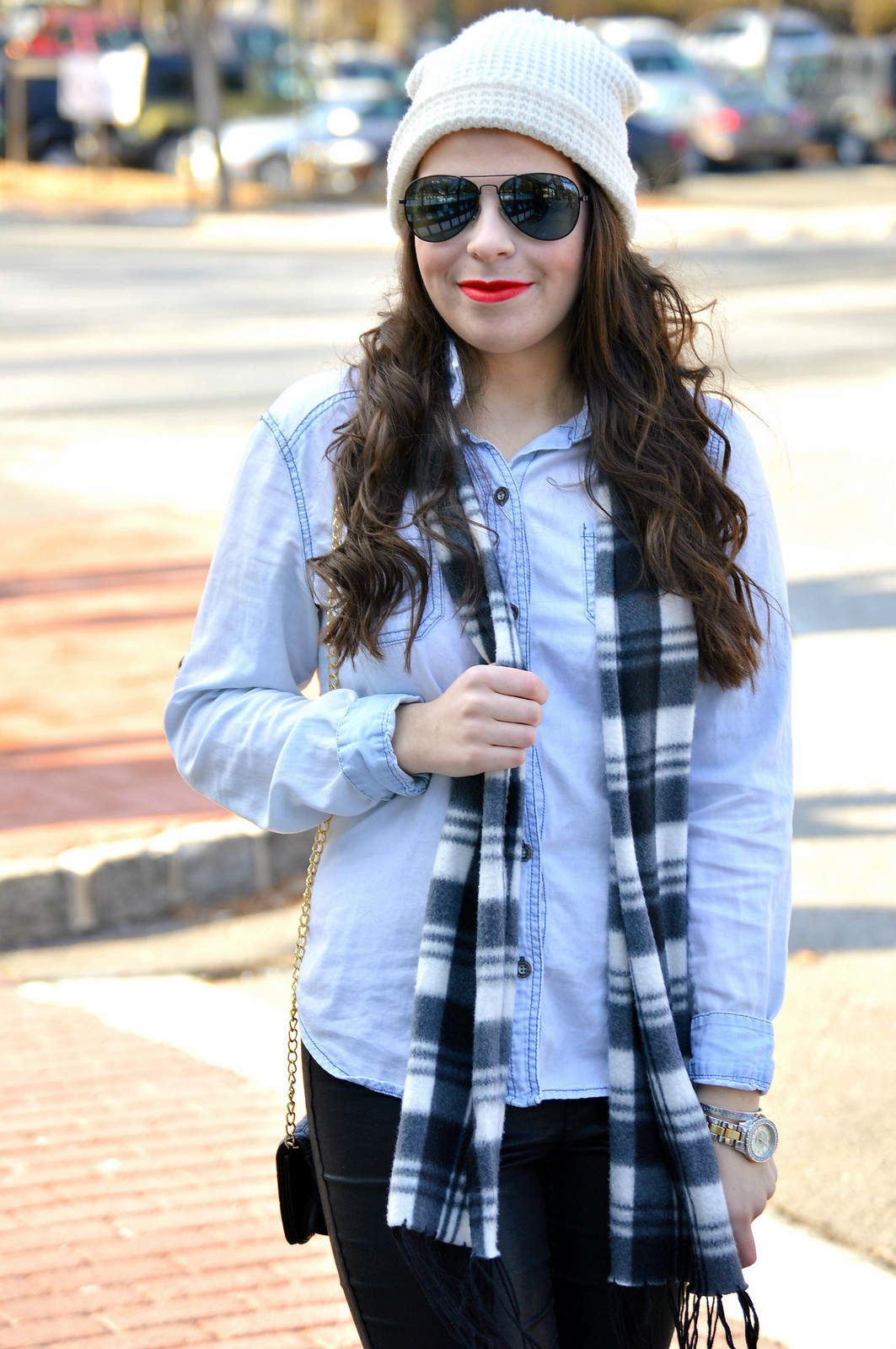 leather pants and plaid scarf