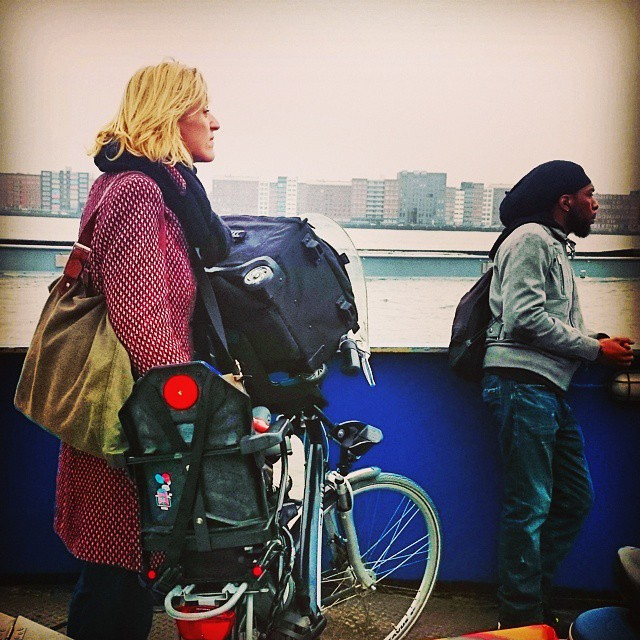 Taking a suitcase in a child seat crossing the IJ by ferry #amsterdamnoord #amsterdam #dutchbike #urbantransport #oostveer #ilovenoord #cyclechic #ij #ferry