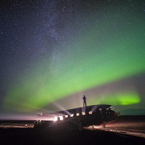 Milky Way.. Northern lights.. And a downed US military plane on a black sand beach in the middle of nowhere. Ultimate solitude in Iceland