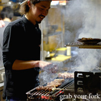 Cooking yakitori skewers over charcoal at Chaco Bar, Darlinghurst