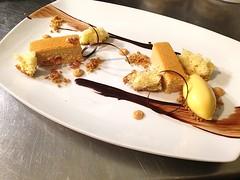 Caramel Cheesecake with madeline sponge, milk confit, passion fruit ginger sorbet at Troquet