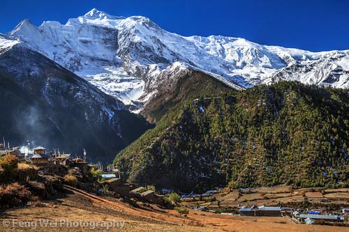 travel nepal color beautiful horizontal landscape asia village view outdoor scenic vista tibetan remote annapurnacircuit annapurna pisang gandaki lowerpisang marshyangdi annapurnaconservationarea