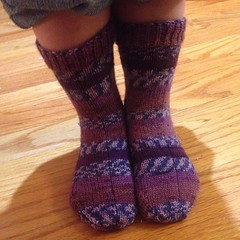 She had to try them on. Happy happy joy joy! #knit #purple #stripes #socks