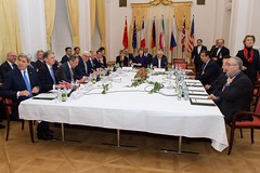 Foreign Ministers from the P5+1 nations - John Kerry of the United States, Philip Hammond of the United Kingdom, Sergey Lavrov of Russia, Frank-Walter Steinmeier of Germany, Laurent Fabius of France, and Wang Yi of China - sit at a table with Baroness Catherine Ashton of the European Union and Foreign Minister Javad Zarif of Iran and his delegation in Vienna, Austria, on November 24, 2014, before a multilateral meeting about the future of Iran's nuclear program. [State Department photo/ Public Domain]