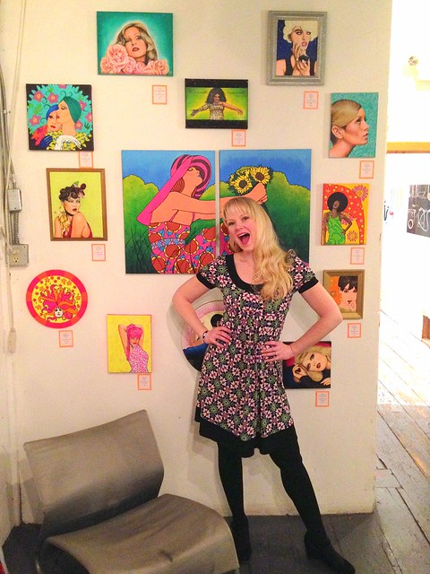 portrait of the artist with her art happy to be part of an art show YAY!