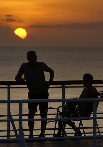 cruise sunset woman man silhouette couple ship sony dream 11 atlantic deck thomson railing trans a77 carabbean