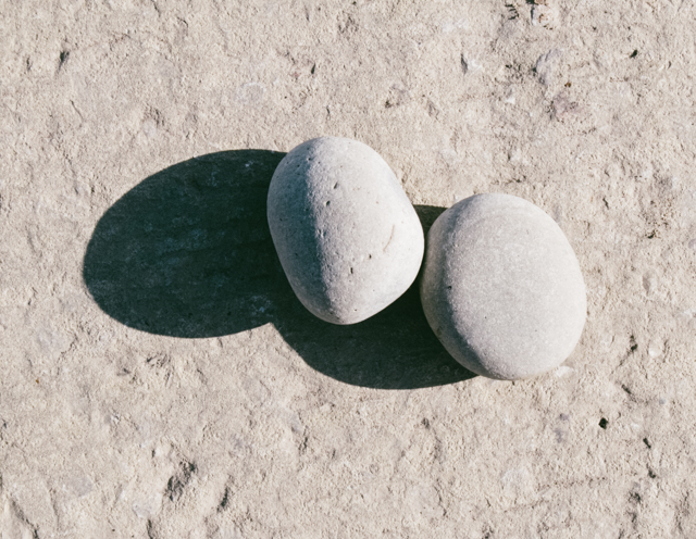 rounded pebbles on concrete
