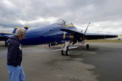 U.S. Secretary of State John Kerry looks at an F/A-18 fighter jet used by the Blue Angels, the U.S. Navy's flight demonstration team, as he stopped at Joint Base Elmendorf-Richardson on July 27, 2016, for an aircraft re-fueling while the team was in town to perform at the upcoming Arctic Thunder air show. [State Department Photo/ Public Domain]