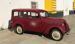 moskvitch 400-420(0.0), compact sport utility vehicle(0.0), city car(0.0), compact car(0.0), sedan(0.0), automobile(1.0), vehicle(1.0), renault juvaquatre(1.0), antique car(1.0), classic car(1.0), vintage car(1.0), land vehicle(1.0), motor vehicle(1.0),