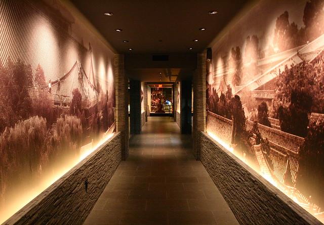 Walkway flanked with huge prints of Jiang Nan scenery
