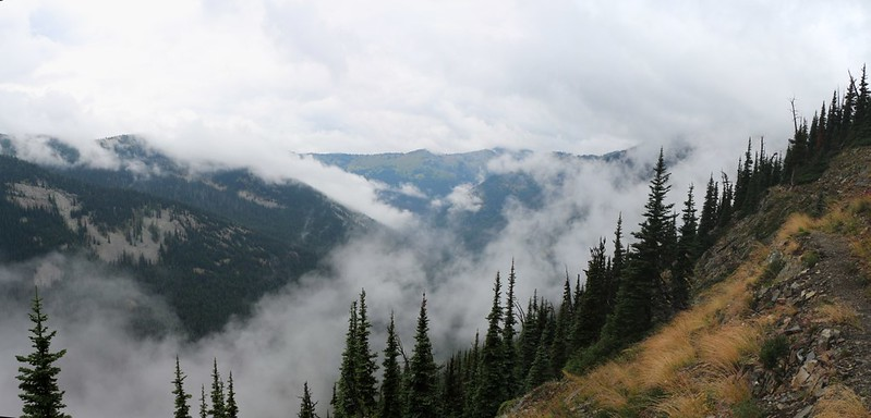 Panorama shot of misty clouds rising above Slate Creek from the PCT just south of Harts Pass