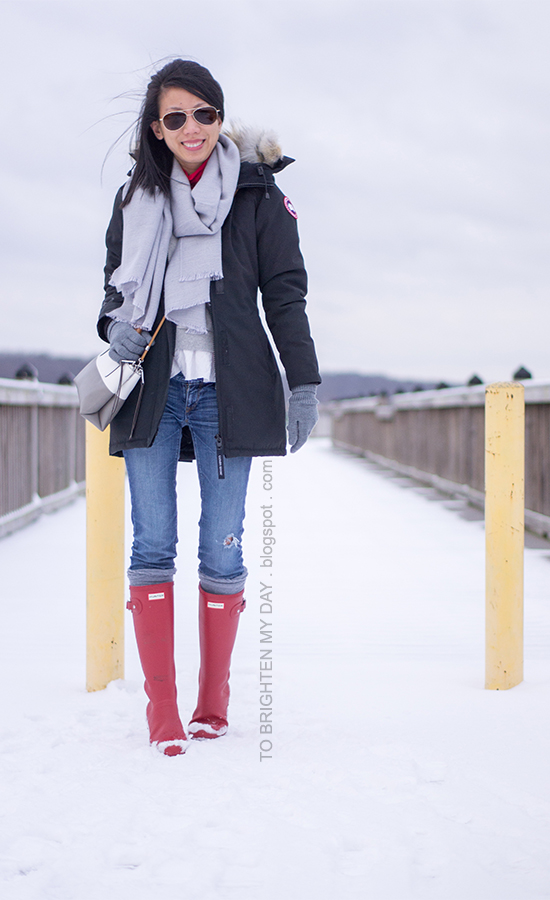 gray scarf, black parka, gray ruffled sweatshirt, red rain boots