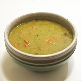 green soup with roasted carrots