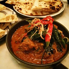 Lamb shoulder shimmered with meat curry powder and Nan Bread