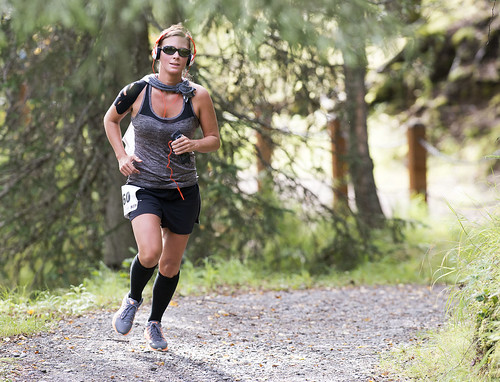 Shari BeDunnah runs through Kenai Municipal Park on her way to a 25:48 finish. The course took runners through Old Town Kenai, down to the beach, up a trail through Kenai Municipal Park, and down the Kenai Spur Highway back to the Kenaitze campus.