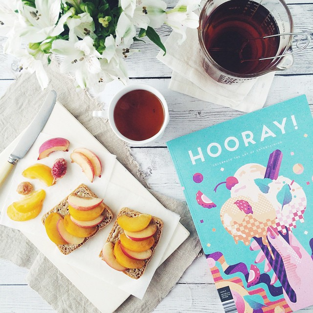 The toast with cinnamon tahini, white nectarines and golden plums (!!) was for breakfast, the @stormandindia Coconut Chai is being refreshed all day and the @hooraymagau indulgence is for when work is done.