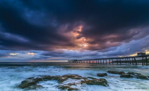 ocean longexposure sea sky sun storm water rain clouds sunrise golden pier nikon rocks waves slow sigma wideangle wharf nsw shutter centralcoast swell uwa catherinehillbay d5300