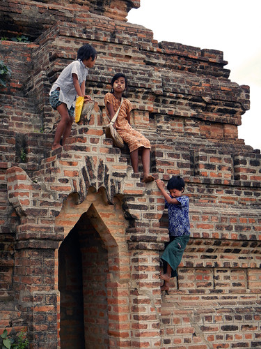 Children climbing a small brick temple in Bagan, Myanmar
