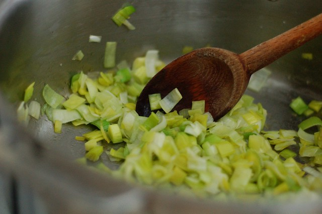 Sauteeing the leeks for the vichyssoise (potato leek) soup by Eve Fox, the Garden of Eating, copyright 2015