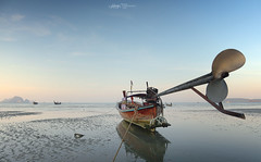 Long Tail Boat in low tide. Ao Nang, Krabi, Thailand.