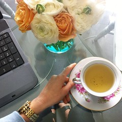afternoon tea at desk with flowers