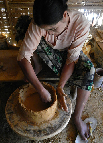 Potter working in the pottery village on Inle Lake, Myanmar