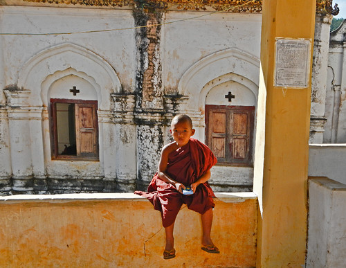 A Child Monk Playing an Electronic Game at the Village at the End of Inle Lake, Myanmar