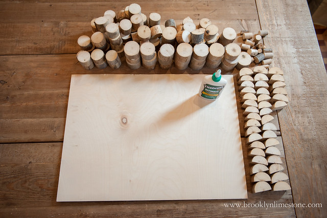 Supplies to make wood doormat  - at the top full circle slices, to the left 1/2 circle slices, a flat board and wood glue