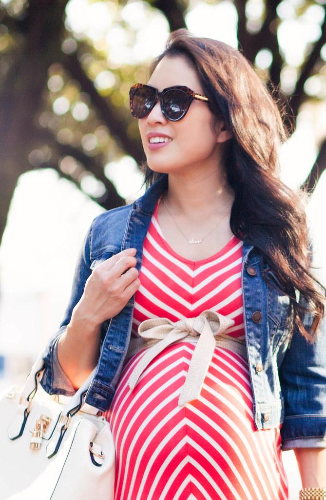 "<a href=""https://cuteandlittle.com"" rel=""nofollow"">cuteandlittle.com</a>   petite fashion blog   motherhood maternity coral chevron maxi dress, gold obi belt, cropped denim jacket, white leather satchel, gold pumps   spring outfit"