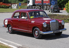 austin fx4(0.0), compact car(0.0), automobile(1.0), vehicle(1.0), mercedes-benz w120(1.0), mid-size car(1.0), antique car(1.0), sedan(1.0), classic car(1.0), vintage car(1.0), land vehicle(1.0), luxury vehicle(1.0),