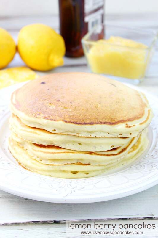 Lemon Berry Pancakes stacked up on a plate.