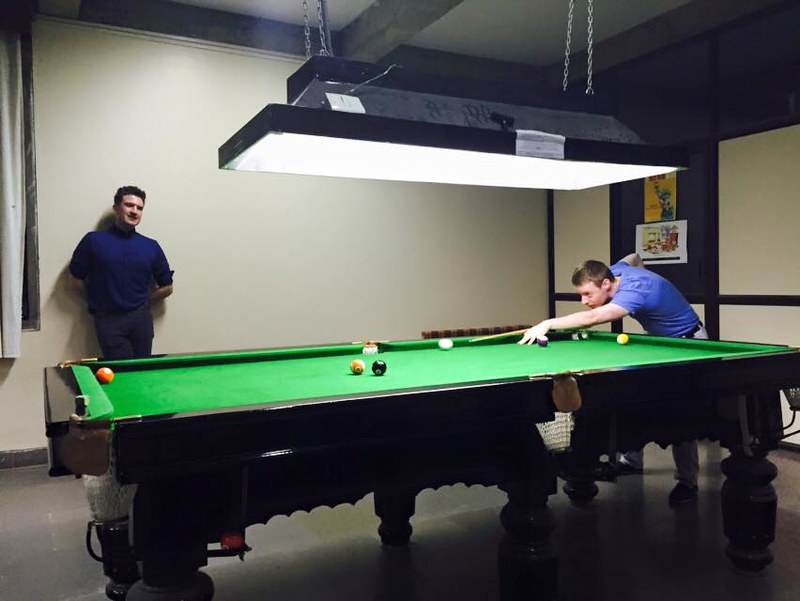 Graham playing snooker with Mick
