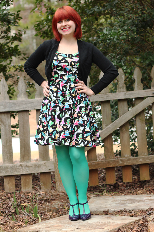Retro Colorful Martini Print Dress, Black Cardigan, Light Green Tights, and Purple Heels