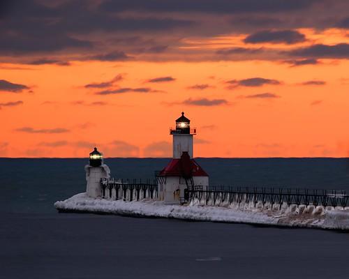 winter sunset lighthouse snow ice lakemichigan greatlakes nikkor400mmf56edif sonyalpha7rilce7ra7r