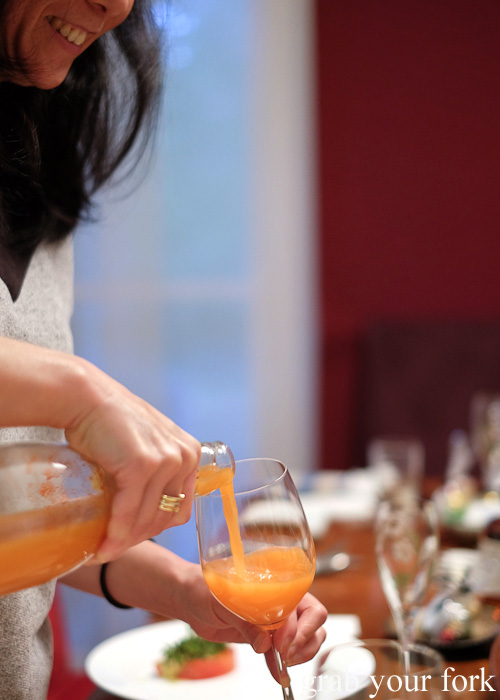 Pouring the kefir carrot juice pairing at the Stomachs Eleven Christmas dinner 2014
