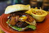 Char-grilled quarter pound chorizo-beef patty, fried egg, romaine leaf, 2 strips of thick-cut bacon, hash browns and finished off with smoky chipotle ketchup