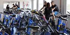 endurance sports(0.0), sport venue(0.0), vehicle(0.0), sports(0.0), room(1.0), indoor cycling(1.0), physical fitness(1.0), physical exercise(1.0), bicycle(1.0), gym(1.0),