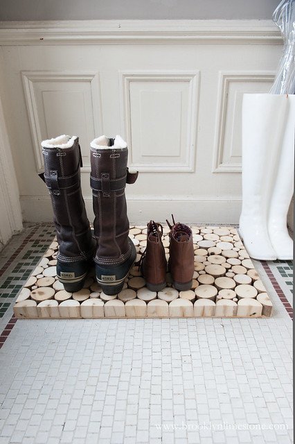 Wood Doormat Boot Tray on tiled floor holding two pairs of boots