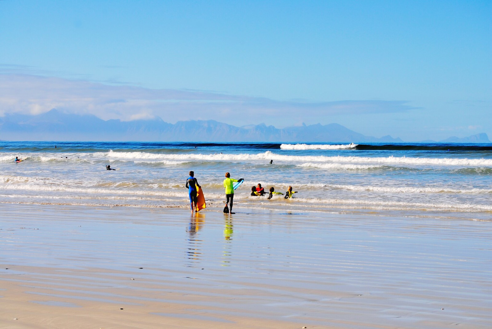 Surfing at Muizenberg Beach, South Africa.