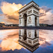 Arc de Triomphe puddle mirror with a cloudy sky by Loïc Lagarde
