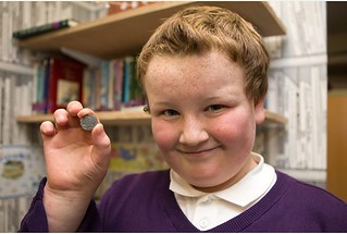 Boy find Tudor sixpence in snowball