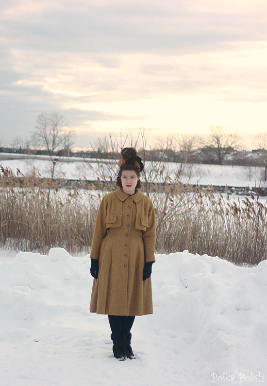 yellow coat in snow 1