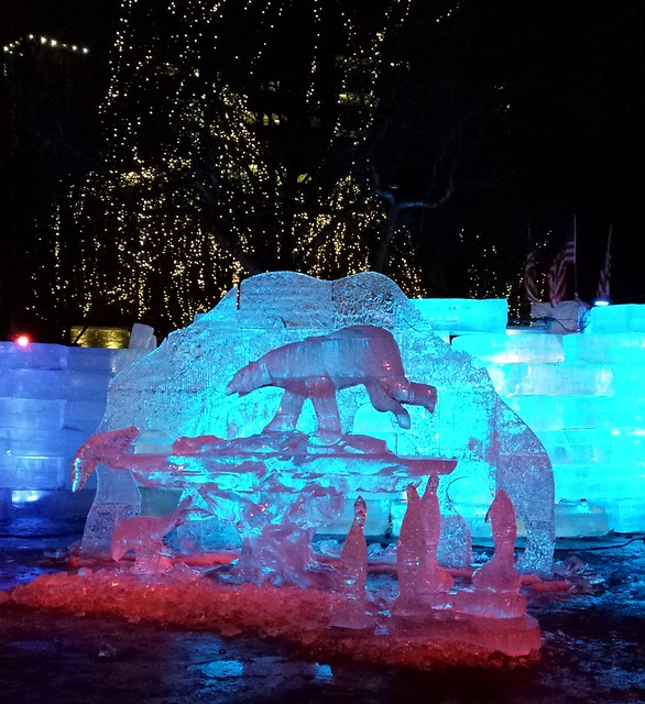 Ice sculpture: bear with fish and penguins