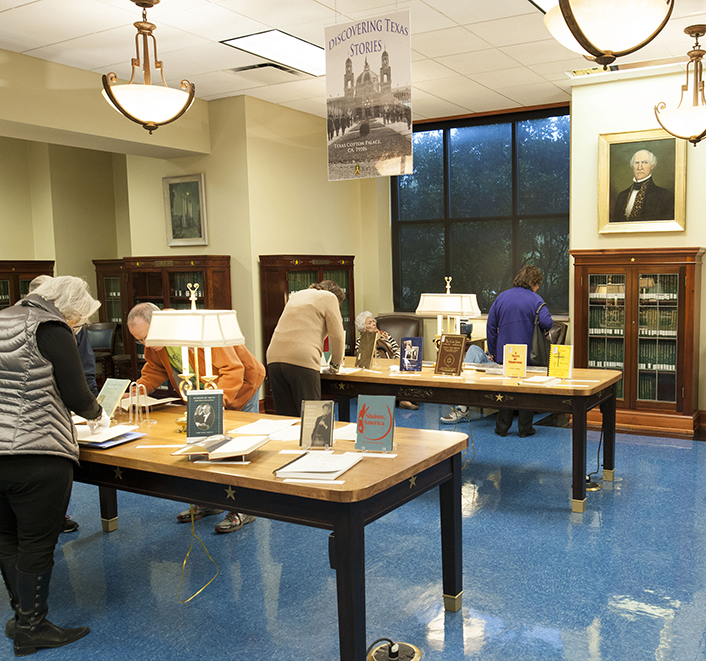 Texas  Jewish Historical Society members exploring display in Texas Collection reading room, 2015